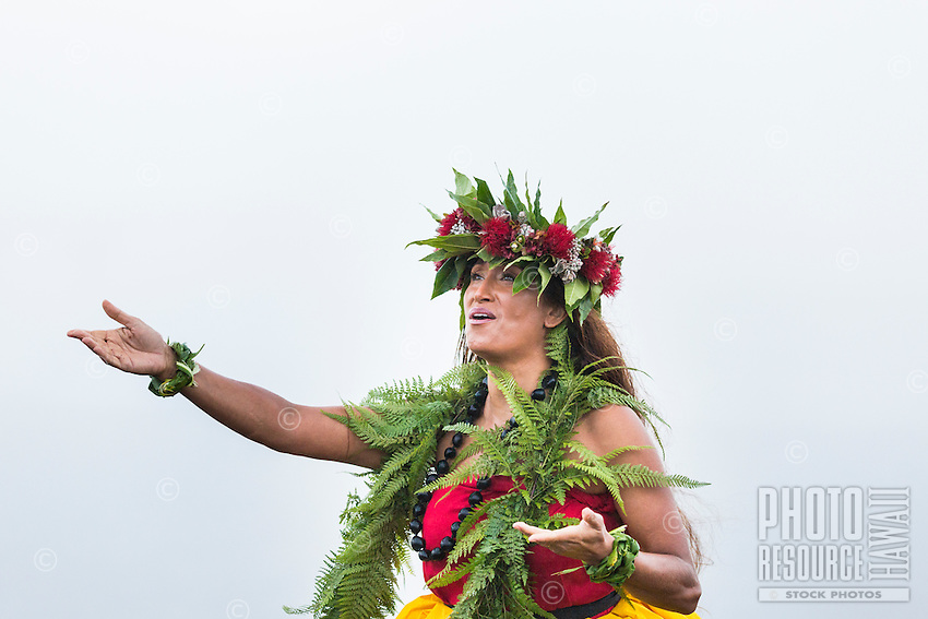 A Hawaiian cultural practitioner and dancer offers a chant at Halema'uma'u Crater in honor of the goddess Pele, Hawai'i Volcanoes National Park, Hawai'i Island.