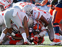 Illinois Fighting Illini running back Cameron Tucker (26) is stopped on fourth down by the Ohio State Buckeyes defense in the second half of their game at Memorial Stadium in Champaign, IL on November 14, 2015.  (Dispatch photo by Kyle Robertson)