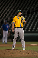 AZL Athletics relief pitcher Dallas Woolfolk (64) looks to his catcher for the sign during an Arizona League game against the AZL Cubs 1 at Sloan Park on June 28, 2018 in Mesa, Arizona. The AZL Athletics defeated the AZL Cubs 1 5-4. (Zachary Lucy/Four Seam Images)