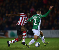 `Lincoln City's John Akinde vies for possession with Yeovil Town's Adel Gafaiti<br /> <br /> Photographer Andrew Vaughan/CameraSport<br /> <br /> The EFL Sky Bet League Two - Lincoln City v Yeovil Town - Friday 8th March 2019 - Sincil Bank - Lincoln<br /> <br /> World Copyright © 2019 CameraSport. All rights reserved. 43 Linden Ave. Countesthorpe. Leicester. England. LE8 5PG - Tel: +44 (0) 116 277 4147 - admin@camerasport.com - www.camerasport.com