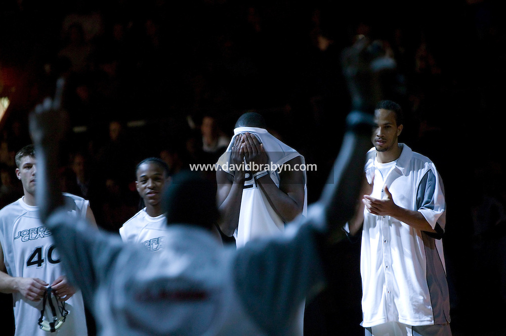 Eric Boateng (2R, background) concentrates during player presentation for the Jordan Classic game at Madison Square Garden in New York City, United States, 16 April 2005.