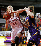 VERMILLION, SD - MARCH 24, 2016 -- Abigail Fogg #44 of South Dakota shoots past Jen Keitel #42 during their WNIT game Thursday evening at the Dakotadome in Vermillion, S.D.  (Photo by Dick Carlson/Inertia)