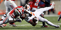 Ohio State Buckeyes quarterback Cardale Jones (12) brings down former high school teammate Illinois Fighting Illini defensive back V'Angelo Bentley (2) after a fumble that was overturned in the third quarter of the NCAA football game at Ohio Stadium on Saturday, November 1, 2014. (Columbus Dispatch photo by Jonathan Quilter)