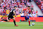 Angel Correa of Atletico de Madrid (R) in action against Dani Garcia Carrillo of SD Eibar (L) during the La Liga match between Atletico Madrid and Eibar at Wanda Metropolitano Stadium on May 20, 2018 in Madrid, Spain. Photo by Diego Souto / Power Sport Images