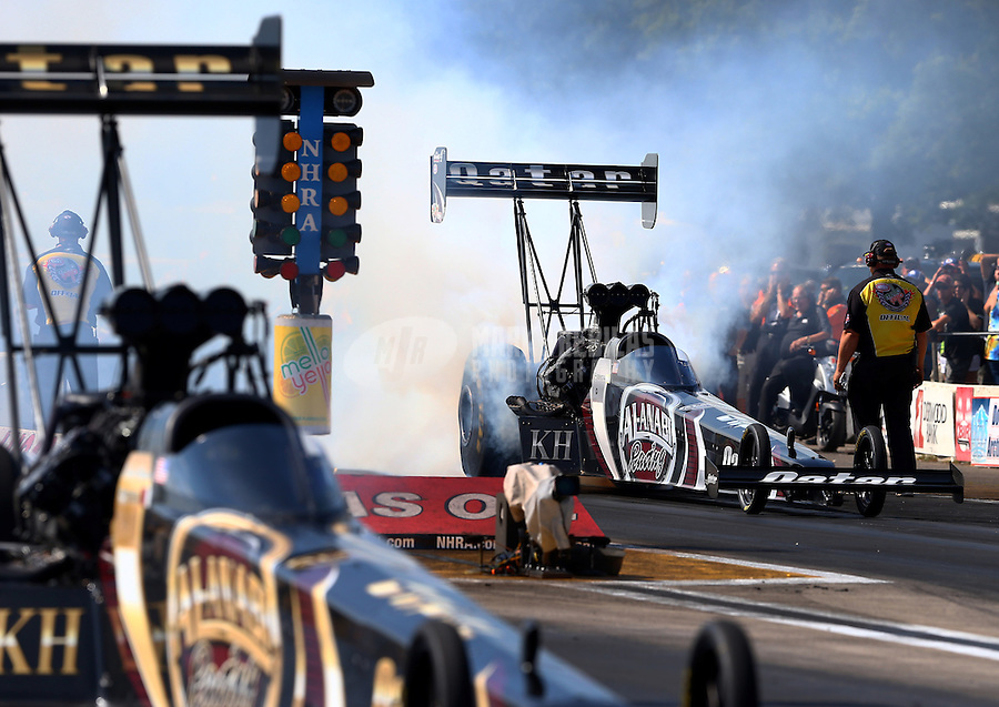 Aug. 17, 2013; Brainerd, MN, USA: NHRA top fuel dragster driver Shawn Langdon during qualifying for the Lucas Oil Nationals at Brainerd International Raceway. Mandatory Credit: Mark J. Rebilas-