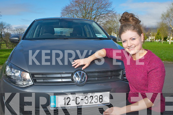 Siobhain Griffin Castlemaine with the Volkswagen Polo car she won in UCC by keeping her hand on the car for 65 hours ........