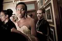 JOHANNESBURG, SOUTH AFRICA - FEBRUARY 16: Models wait backstage for the Klûk CGDT label fashion show at the Rand Club at Joburg Fashion Week on February 16, 2011, in Johannesburg, South Africa. Klûk CGDT, created by the designers Malcolm KLûK and Christiaan Gabriel Du Toit and their brand is not so much about clothes, but rather life and a holistic experiential, boundary blurring approach to style that encompasses all the senses. Trends influencing their collection include touches of tribal, vintage and the baroque. Their couture collection only to order. The event was held at the Rand Club, A former private all male club during the Apartheid era. Here, the wealthy industrialists of the country networked, wined and dined. The club now allows female members. (Photo by Per-Anders Pettersson)