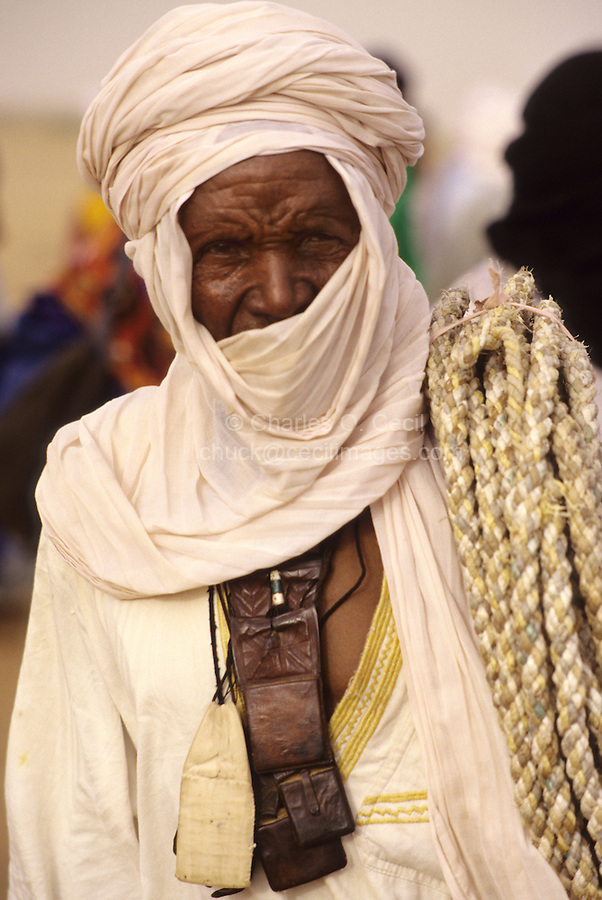 In-Gall, Niger - Tuareg Man with Wallet, Rope.  Veil Covers Mouth, as is the Tuareg Custom.