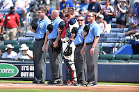 Atlanta Braves catcher A.J. Pierzynski (15) with umpires Ron Kulpa, Chris Conroy, Jerry Meals and Sean Barber before a game against the Chicago Cubs at Turner Field on June 11, 2016 in Atlanta, Georgia. The Cubs defeated the Braves 8-2. (Tony Farlow/Four Seam Images)