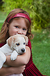 USA, California, Fairfax, portrait of girl (4-5) holding Beagle puppy, outdoors