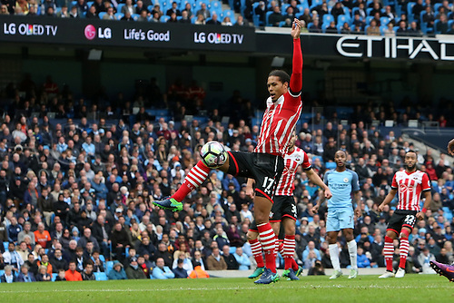 23.10.2016. The Etihad, Manchester, England. Premier League Football. Manchester City versus Southampton. Virgil van Dijk of Southampton clears a dangerous ball across the six yard box.