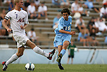 06 September 2009: UNC's Michael Farfan (19) shoots past Evansville's Robby Lynch (7). The University of North Carolina Tar Heels defeated the Evansville University Purple Aces 4-0 at Fetzer Field in Chapel Hill, North Carolina in an NCAA Division I Men's college soccer game.