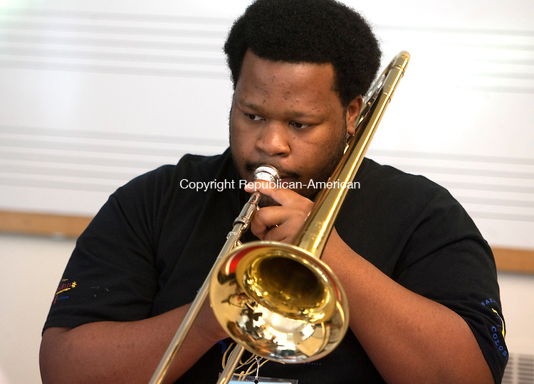KENT, CT 20  JULY, 2010-072010JS02-Music student Kelvin Grant of New Carrollton, Maryland, plays the trombone during the Litchfield Jazz Festival jazz camp Tuesday at the Kent School in Kent. <br /> Jim Shannon Republican-American