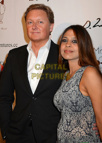 Henrik Fisker, Geeta Gupta.Mr. C Beverly Hills Hosts Domingo Zapata's Oscar Art Show at Mr. C Beverly Hills, California, USA..February 22nd, 2012.half length black suit jacket white shirt grey gray dress .CAP/ADM/BT.©Birdie Thompson/AdMedia/Capital Pictures.
