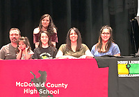 Courtesy Photo Madison Smith (bottom row, middle) recently signed to cheer at Missouri Southern State University. Front row, left to right: Jason Smith (dad), Jazmine Stewart (niece), Madison, Misty Smith (mom) and Taylor Stewart (sister). Back row: MCHS cheer coach, T.C. Banta.