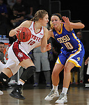 SIOUX FALLS, SD - MARCH 8:  Allison Arens #10 of South Dakota drives on Kerri Young #10 of South Dakota State during the women's championship game at the 2016 Summit League Tournament at the Denny Sanford Premier Center in Sioux Falls, S.D. (Photo by Dick Carlson/Inertia)