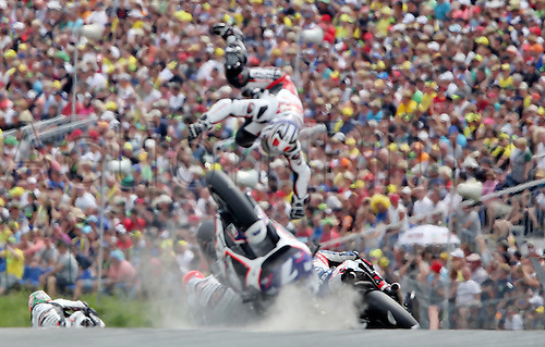 12.07.2015. Sachsenring, Germany MotoGP. Gopro Motorrad Grand Prix Germany.  Japanese MotoGP rider Hiroshi Aoyama of AB Motoracing crashes during the MotoGPrace at the Motorcycle World Championship Grand Prix of Germany at the Sachsenring racing circuit in Hohenstein-Ernstthal, Germany, 12 July.