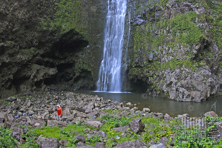 Hikers rest at the pool, Halawa Falls (left fork), Molokai