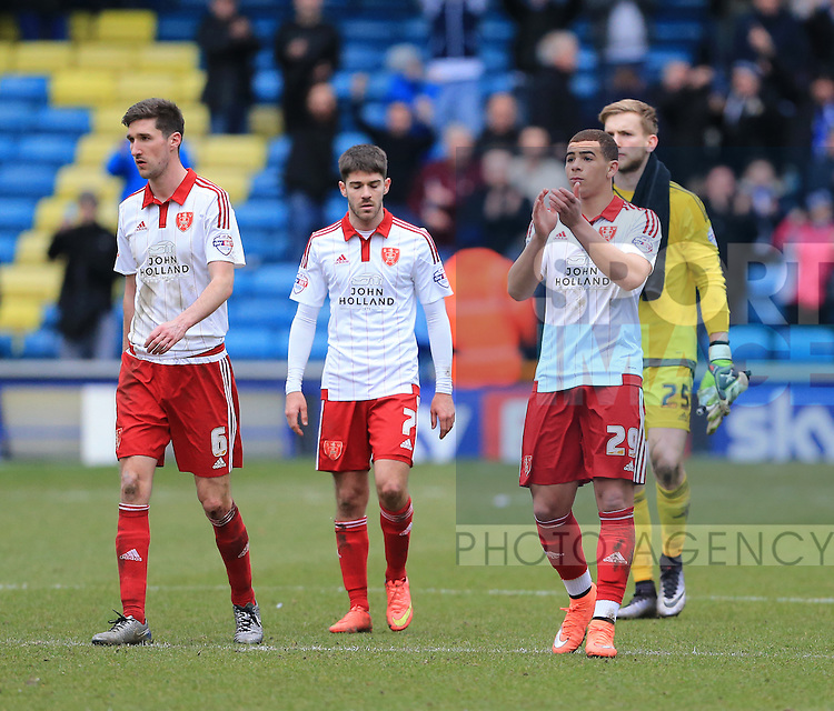 Sheffield United's Chris Basham, Ryan Flynn and Che Adams look on dejected at the final whistle during the League One match at The Den.  Photo credit should read: David Klein/Sportimage