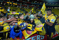 Julian Savea signs autographs after the Super Rugby match between the Hurricanes and Jaguares at Westpac Stadium, Wellington, New Zealand on Saturday, 9 April 2016. Photo: Dave Lintott / lintottphoto.co.nz