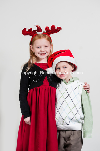 WATERBURY, CT-10 December 2014-121014EC09-  Madison Arthur, 8, and her brother Logan, 4, of Winsted. Madison wants a Monster High Doll for Christmas while her brother wants a toy plane. Erin Covey Republican-American