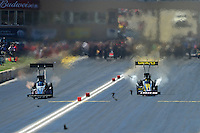 Jul, 22, 2012; Morrison, CO, USA: NHRA top fuel dragster driver Morgan Lucas (right) races alongside Bob Vandergriff Jr through a flock of birds at the finish line during the Mile High Nationals at Bandimere Speedway. Mandatory Credit: Mark J. Rebilas-