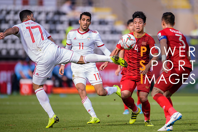 Mehdi Taremi of Iran (L) fights for the ball with B T Dung of Vietnam (2nd R) during the AFC Asian Cup UAE 2019 Group D match between Vietnam (VIE) and I.R. Iran (IRN) at Al Nahyan Stadium on 12 January 2019 in Abu Dhabi, United Arab Emirates. Photo by Marcio Rodrigo Machado / Power Sport Images