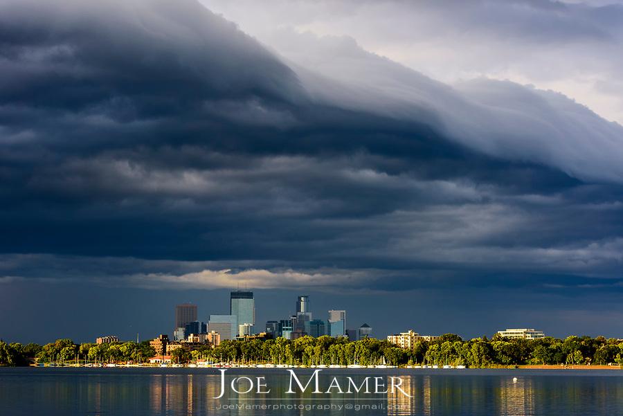 Storm clouds over Minneapolis and Lake Calhoun.