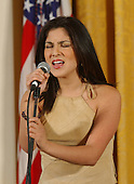 """Jaci Vasquez sings the National Anthem during a """"Celebration of National Hispanic Heritage Month"""" in the East Room of the White House in Washington, D.C. on October 12, 2001.                                                                                Credit: Ron Sachs / CNP."""