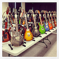 A ton of Paul Reed Smith guitars line a table in a room at the PRS guitar factory in Stevensville, Maryland on March 20, 2013.