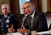 United States President Barack Obama (R) meets with Combatant Commanders and Joint Chiefs of Staff  with Vice President Joe Biden (C) in the Cabinet Room of the White House, in Washington, DC, April 5, 2016. <br /> Credit: Aude Guerrucci / Pool via CNP