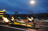 Jun. 1, 2012; Englishtown, NJ, USA: NHRA top fuel dragster driver Morgan Lucas (near) races alongside Shawn Langdon during qualifying for the Supernationals at Raceway Park. Mandatory Credit: Mark J. Rebilas-