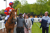 Winner of The Smith & Williamson Fillies' Novice Stakes (Div 2) La Lune ridden by Charles Bishop and trained by Henry Candy is led into the Winners enclosure during Afternoon Racing at Salisbury Racecourse on 16th May 2019
