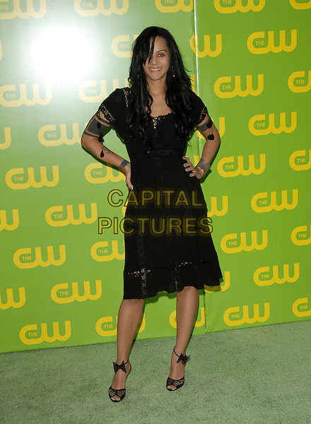 PERSIA WHITE.The CW Launch Party held at Warner Brothers' Studios in Burbank, California, USA..September 18th, 2006.Ref: DVS.full length black dress hands on hips tattoos.www.capitalpictures.com.sales@capitalpictures.com.©Debbie VanStory/Capital Pictures