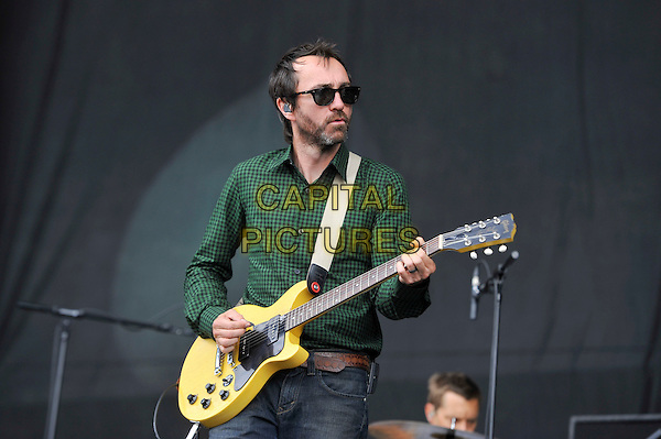James Mercer of The Shins.performing on Day 2 at Reading Festival, Reading, England. .25th August 2012.on stage in concert live gig performance performing music half length black green check shirt sunglasses shades guitar  stubble facial hair   .CAP/MAR.© Martin Harris/Capital Pictures.