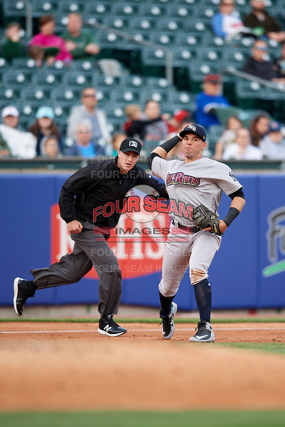 Scranton/Wilkes-Barre RailRiders third baseman Vicente Conde (21) throws to first base in front of third base umpire Brennan Miller during a game against the Buffalo Bisons on May 18, 2018 at Coca-Cola Field in Buffalo, New York.  Buffalo defeated Scranton 5-1.  (Mike Janes/Four Seam Images)