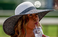 SARATOGA SPRINGS, NY - AUGUST 25: A woman takes a sip of her drink on Travers Stakes Day at Saratoga Race Course on August 25, 2018 in Saratoga Springs, New York. (Photo by Scott Serio/Eclipse Sportswire/Getty Images)