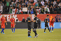 EAST RUTHERFORD, NJ - SEPTEMBER 7: Hirving Lozano #22 of Mexico with Alexis Vega #29 of Mexico at the end of the game during a game between Mexico and USMNT at MetLife Stadium on September 6, 2019 in East Rutherford, New Jersey.