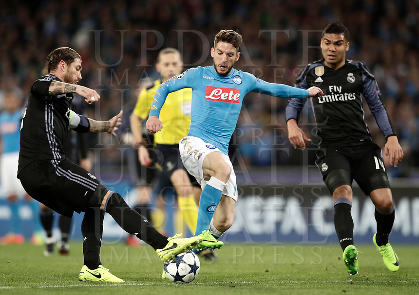 Football Soccer: UEFA Champions League Round of 16 second leg, Napoli-Real Madrid, San Paolo stadium, Naples, Italy, March 7, 2017. <br /> Real Madrid's Sergio Ramos (l) in action with Napoli's Dries Mertens (l) during the Champions League football soccer match between Napoli and Real Madrid at the San Paolo stadium, 7 March 2017. <br /> Real Madrid won 3-1 to reach the quarter-finals.<br /> UPDATE IMAGES PRESS/Isabella Bonotto