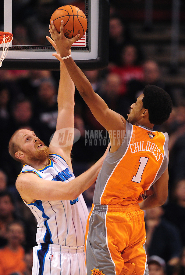Dec. 26, 2011; Phoenix, AZ, USA; Phoenix Suns guard/forward Josh Childress takes a shot against New Orleans Hornets center Chris Kaman at the US Airways Center. The Hornets defeated the Suns 85-84. Mandatory Credit: Mark J. Rebilas-USA TODAY Sports