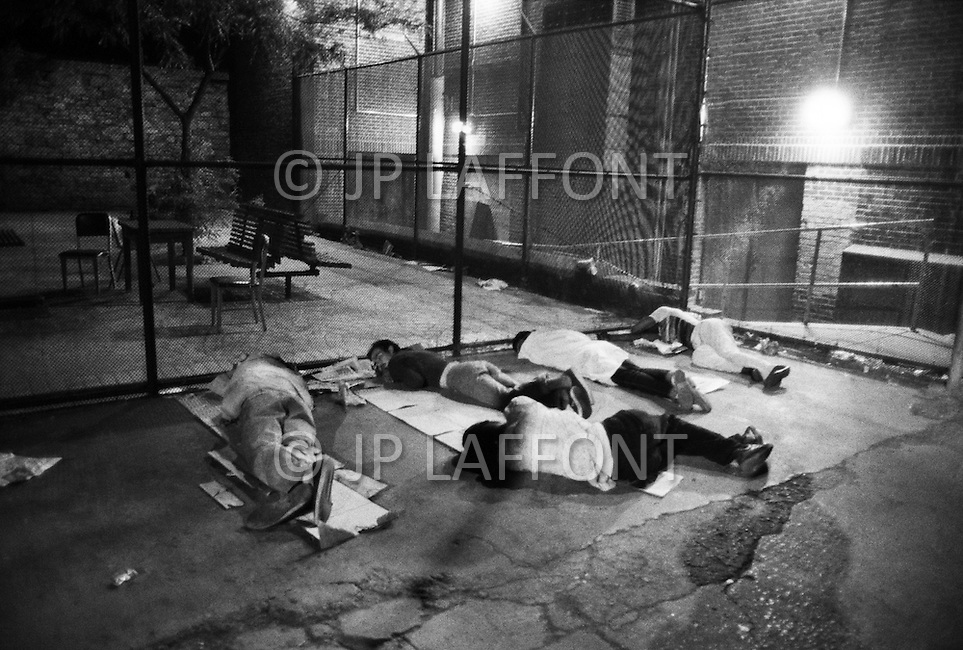 Manhattan, New York City, NY. July, 1987. <br /> Homeless people sleeping on the street in the Lower East Side.