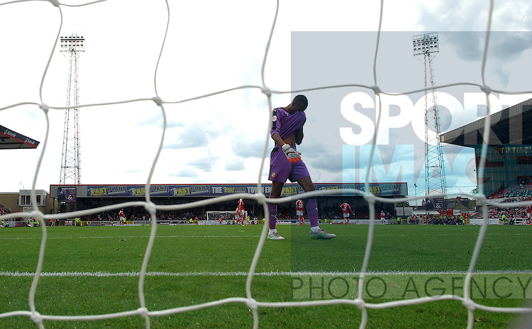 A dejected Swindon Town goalkeeper Lawrence Vigouroux after Billy Sharp of Sheffield United 2nd goal<br /> - English League One - Swindon Town vs Sheffield Utd - County Ground Stadium - Swindon - England - 29th August 2015
