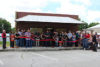 MEGAN DAVIS/MCDONALD COUNTY PRESS On Tuesday, June 18, members of the McDonald County Chamber of Commerce gathered to celebrate as Dallas and Kirby Zumwalt held a ribbon cutting for Earth Labs Nutrition on the Pineville square. The clinic specializes in customized nutritional counseling, alternative health practices and organic supplements.