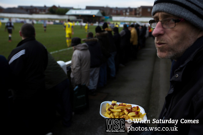 Chorley 2 Altrincham 0, 21/01/2017. Victory Park, National League North. A home supporter with a tray of chips and ketchup watching the action during the first-half at Victory Park, as Chorley played Altrincham (in yellow) in a Vanarama National League North fixture. Chorley were founded in 1883 and moved into their present ground in 1920. The match was won by the home team by 2-0, watched by an above-average attendance of 1127. Photo by Colin McPherson.