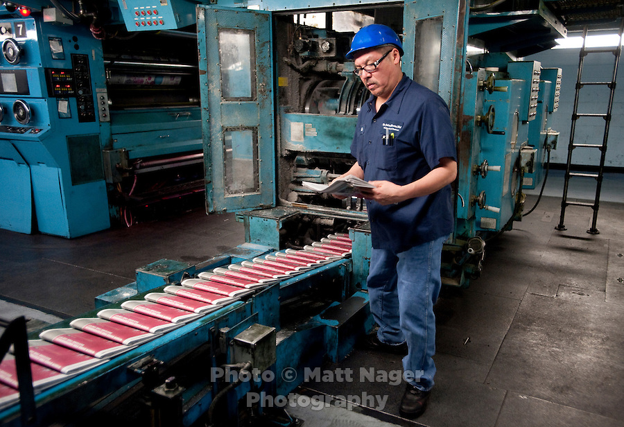 Gary Hoyen (cq) checks a newspaper for mistakes during a press run at the Dallas Morning News printing press in Plano, Texas, US, Thursday, Dec., 17, 2009. ..MATT NAGER/ BLOOMBERG NEWS