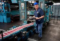 Gary Hoyen (cq) checks a newspaper for mistakes during a press run at the Dallas Morning News printing press in Plano, Texas, US, Thursday, Dec., 17, 2009. ..MATT NAGER/ BLOOMBERG NEWS