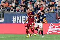 FOXBOROUGH, MA - SEPTEMBER 21: Corey Baird #17 of Real Salt Lake controls the ball as Carles Gil #22 of New England Revolution defends during a game between Real Salt Lake and New England Revolution at Gillette Stadium on September 21, 2019 in Foxborough, Massachusetts.