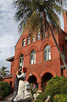 """A large sculpture, """"Time For Fun"""" by Seward Johnson, in front of the Key West Art and Historical Society Museum in the historic Custom House building."""