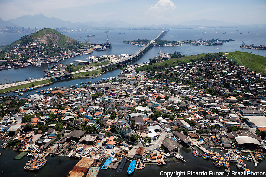 Border of Guanabara Bay at Niteroi city, showing the Rio-Niteroi bridge. The bay has been heavily impacted by urbanization, deforestation, and pollution of its waters with sewage, garbage, and oil spills.
