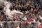 20 March 2008: An unidentified United States fan holds a smoke device in the crowd following a United States goal. The United States U-23 Men's National Team defeated the Canada U-23 Men's National Team 3-0 at LP Field in Nashville,TN in a semifinal game during the 2008 CONCACAF Men's Olympic Qualifying Tournament. With the victory, the United States qualified for the 2008 Beijing Olympics.